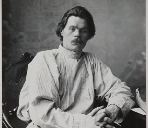 Portrait of Maxim Gorky sitting in an armchair wearing a light shirt. 14728267252 e1607456833364 3