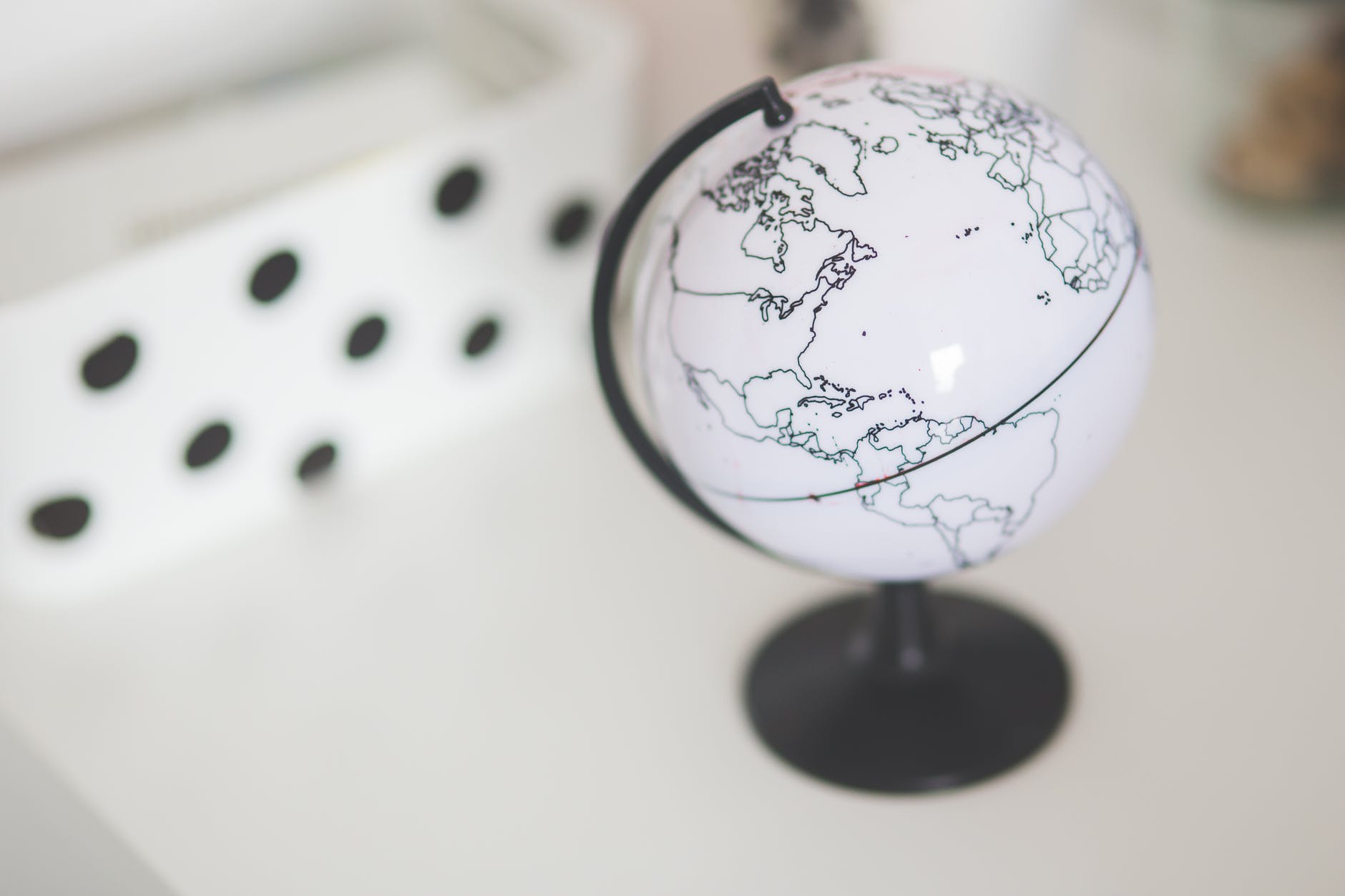 white globe on a desk 4